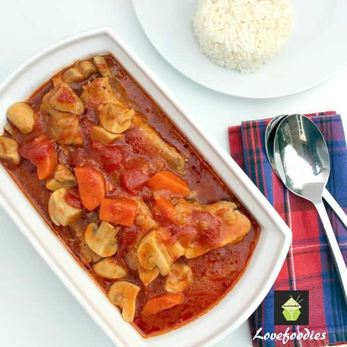Delicious Tomato and Pork Casserole, tender pork, carrots and mushrooms in a fresh tomato sauce, all cooked in one pan on the stove top or oven.