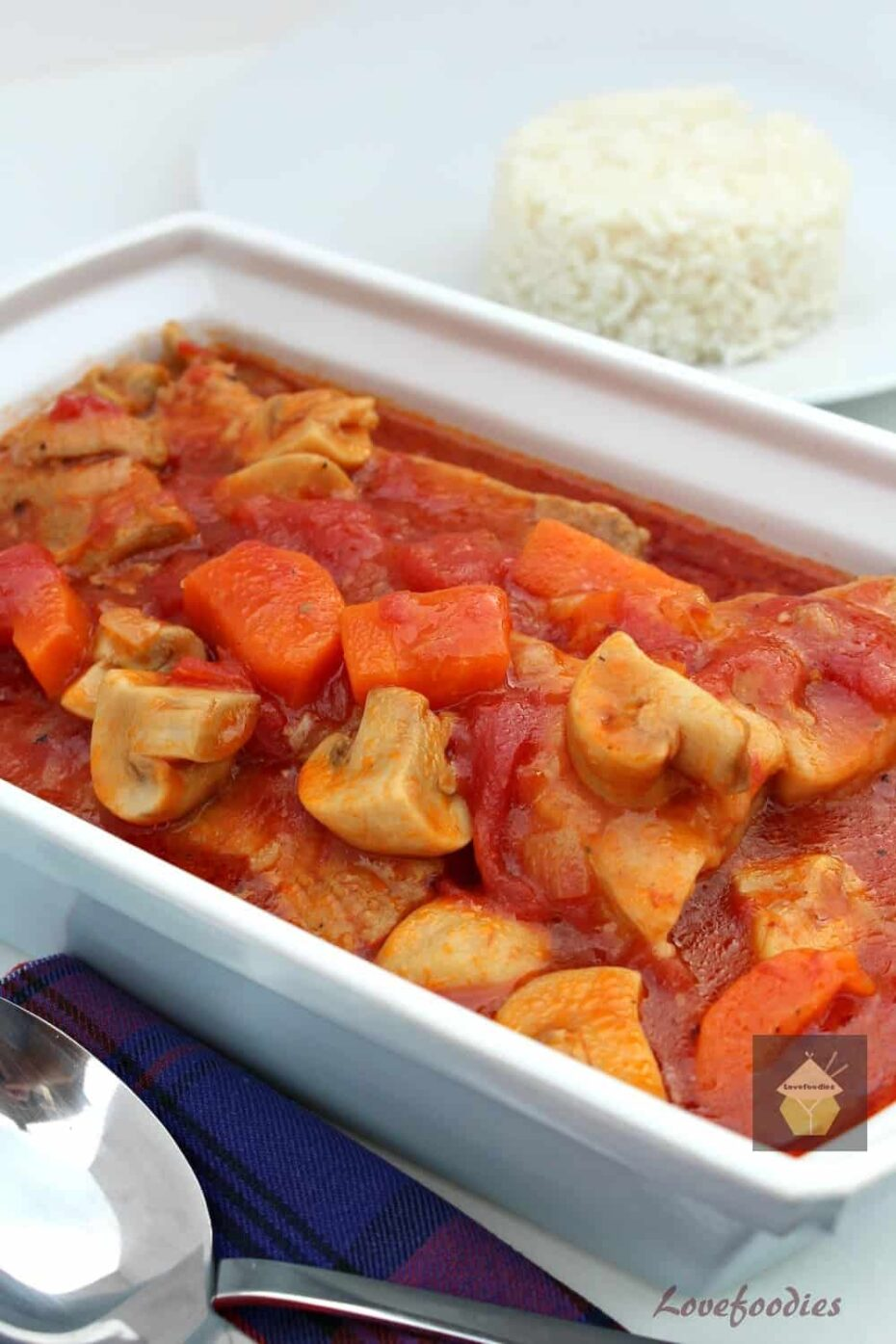 Delicious Tomato and Pork Casserole, tender pork, carrots, and mushrooms in a fresh tomato sauce, all cooked in one pan on the stovetop, multicooker or oven.