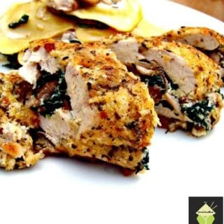 Herb Crusted Stuffed Chicken, a delicious juicy baked chicken breast stuffed with cream cheese and spinach and coated in crispy breadcrumbs.