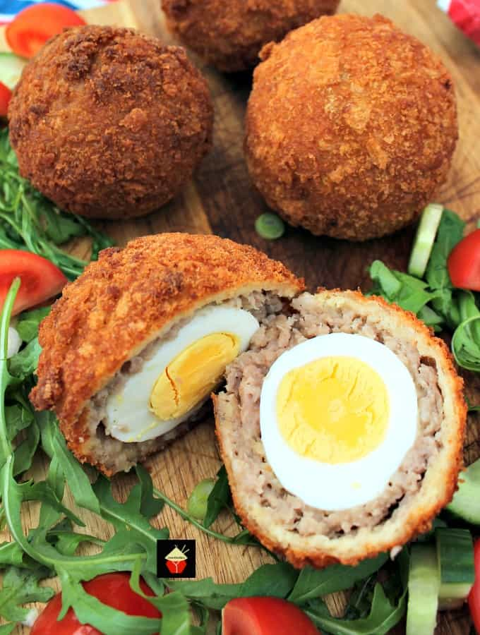 The Best Homemade Scotch Eggs, a popular British snack, perfect for a picnic, breakfast, or any occasion. Delicious eggs wrapped in sausage meat and coated in crispy breadcrumbs.
