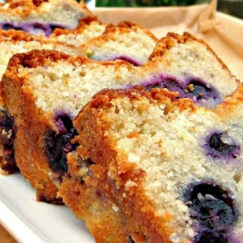 Blueberry Lemon Pound Cake, a delicious soft and moist loaf bursting with juicy blueberries! Perfect with a cup of tea