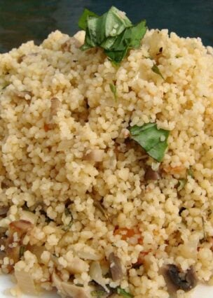 How To Cook Perfect Couscous, tiny steamed balls of durum wheat pasta, simply cooked with fresh ingredients to give it bags of flavor. A perfect side Moroccan side dish