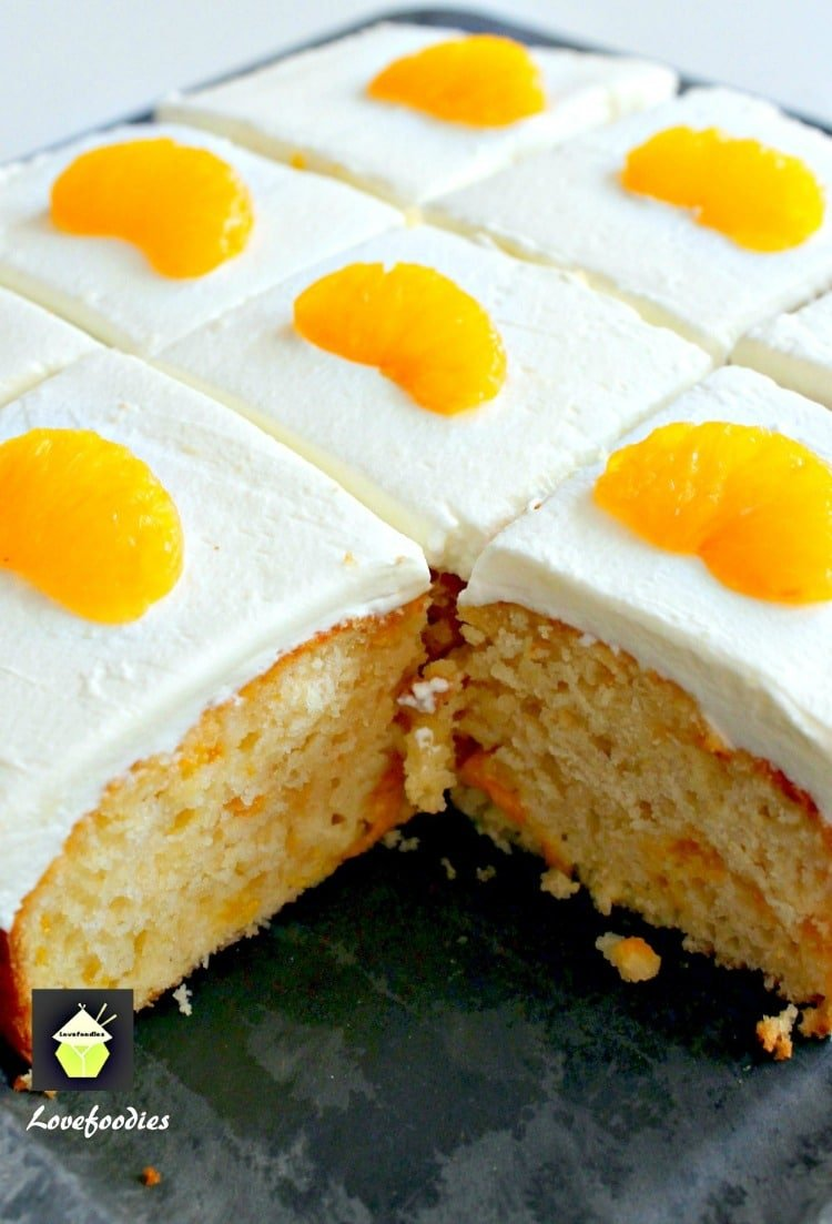 Mandarin Cake. This is a delicious soft and moist cake with juicy mandarins running throughout .