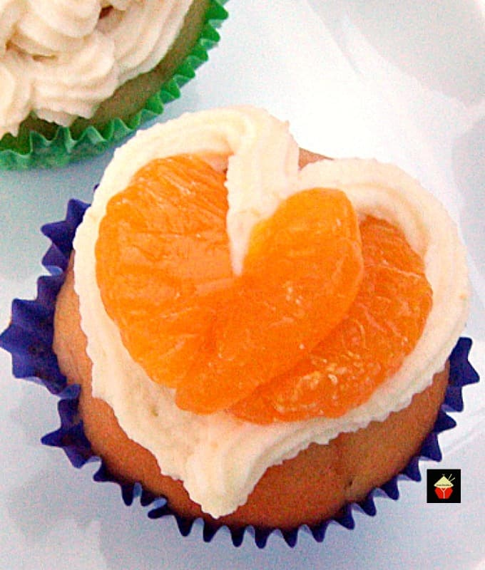 Mandarin Orange Cupcakes with Whipped Cream Topping, easy made from scratch recipe with a creamy frosting, showing decoration and frosting from above