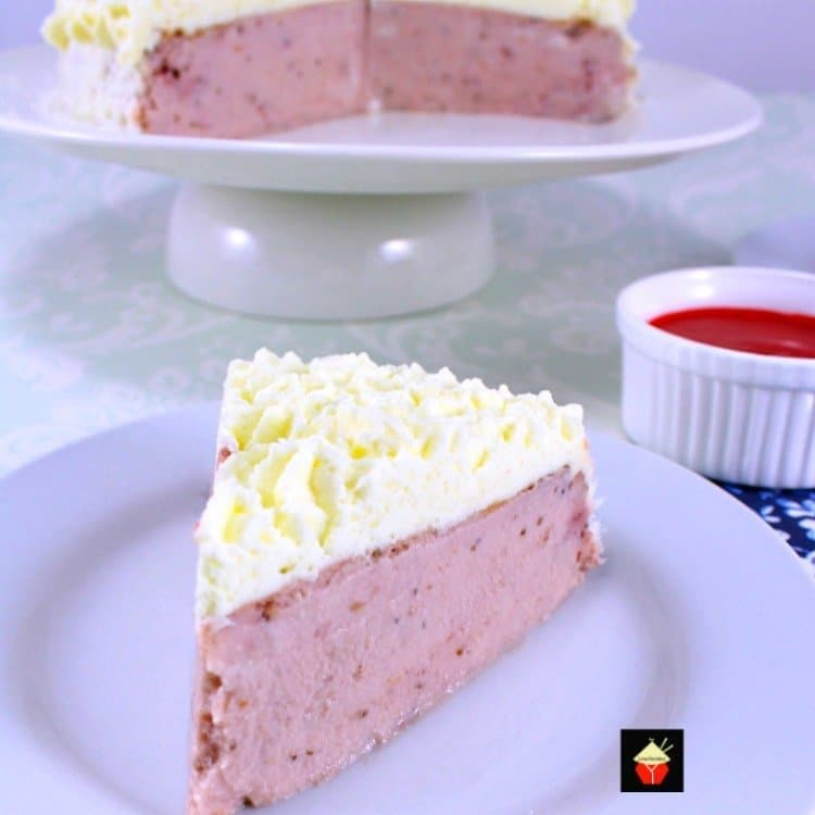 Strawberry and Coconut Ricotta Cheesecake. A delicious fluffy, creamy baked cheesecake with fresh strawberries and coconut in the filling and topped with a fresh strawberry puree. Very easy recipe too!