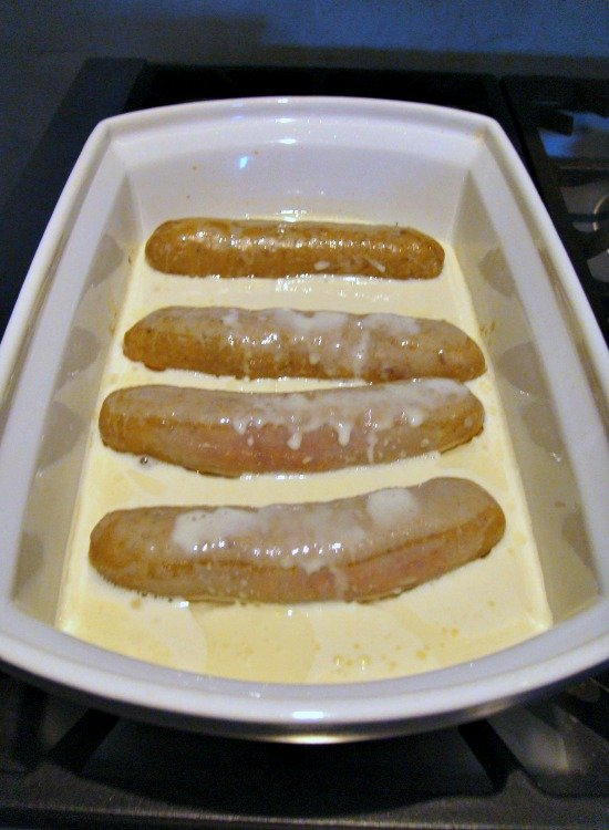British Toad in the Hole showing batter in the oven dish with depth of batter in dish