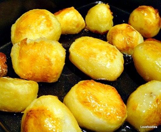 Super Crispy Crunchy Roast Potatoes, transfer to hot oil, roast until golden