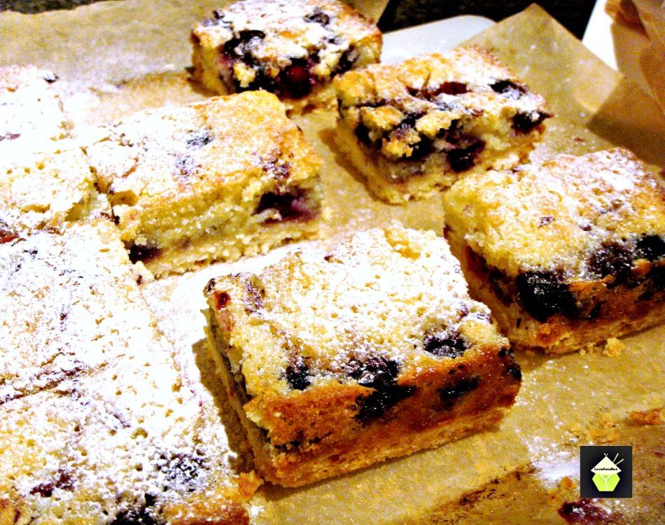 Blueberry Coconut Bars. Delicious layers of blueberry and coconut cake on a shortbread cookie base. Easy to make and perfect for snacks or dessert