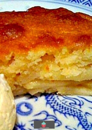 English Eve's Apple Pudding Cake, a lovely layered warm dessert, made of sliced apples and vanilla cake. Easy to make, delicious served with custard or ice cream.