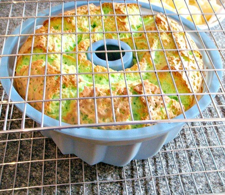 Pandan Chiffon Cake showing hoe to turn cake upside down using cooling rack