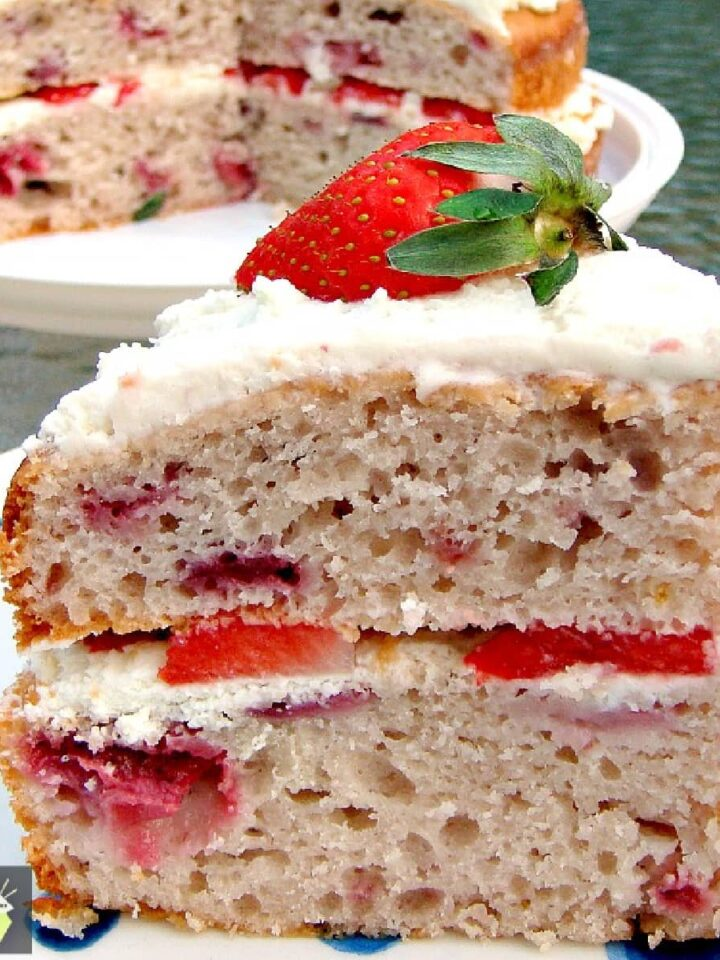 Strawberry Yogurt Cake - This cake is light, fluffy and BURSTING with strawberry flavor! Made from scratch and using fresh ingredients. Easy recipe too. Yummy!
