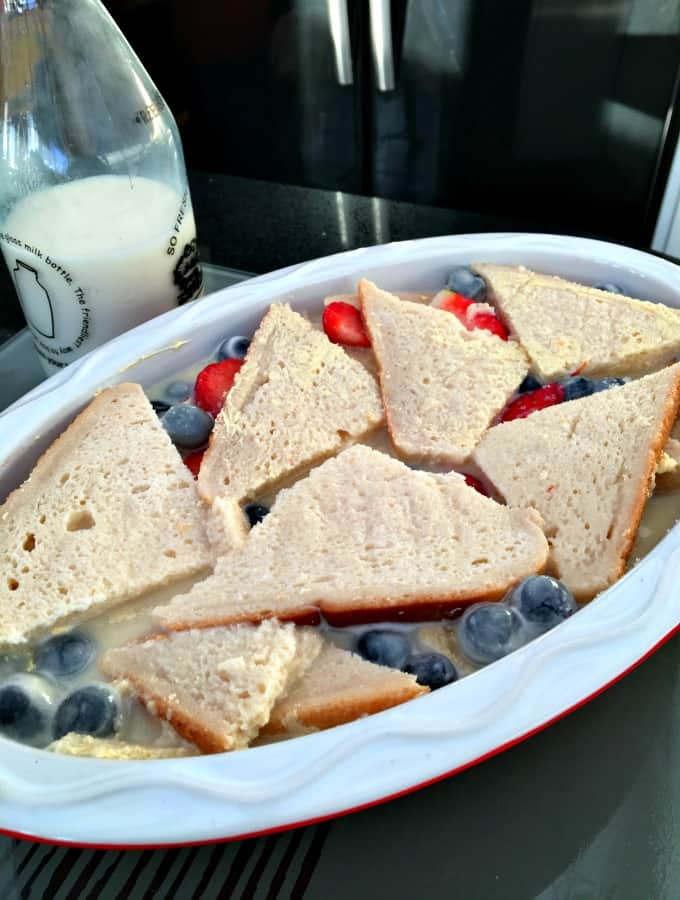 Strawberry and blueberry bread and butter pudding preparation
