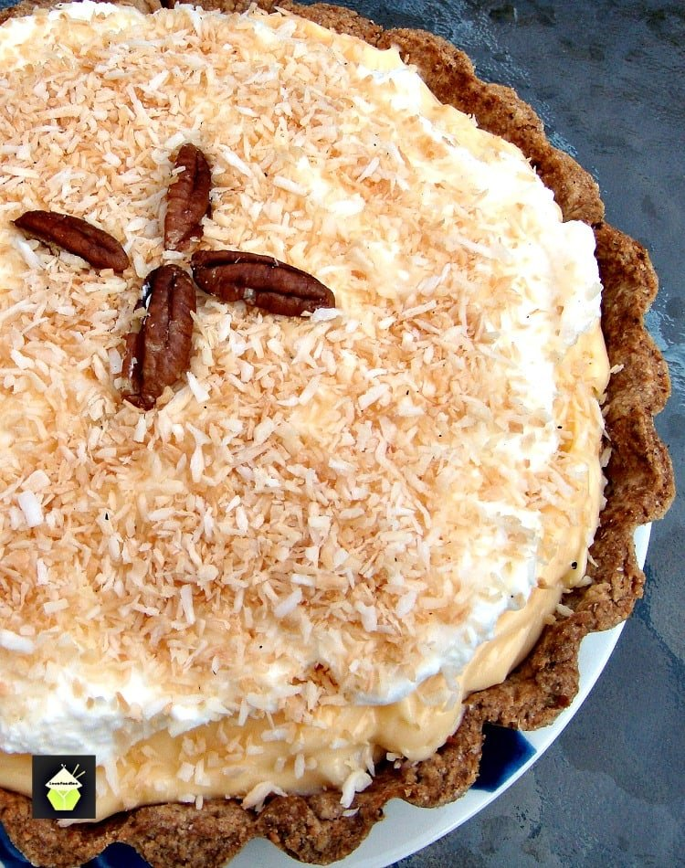 TROPICAL COCONUT PIE! It is so creamy and has a rich coconut flavor, laced throughout with juicy pineapple chunks and a crispy sweet pie crust. Heavenly! | Lovefoodies.com