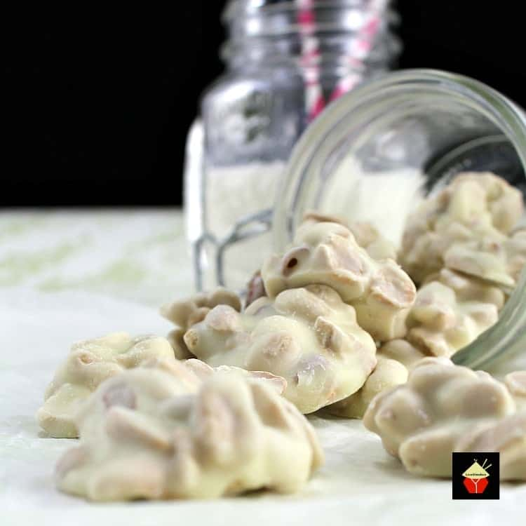 White Chocolate Peanut Clusters ! These little chocolate bites are quick and easy to make. You can also add raisins, your favorite nuts, cranberries, whatever you like! You choose!