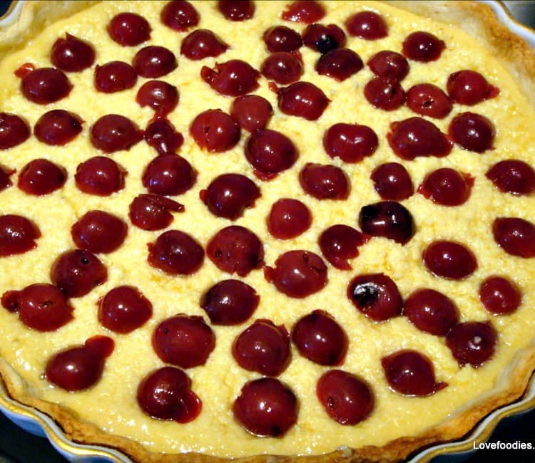 cherries arranged on frangipane