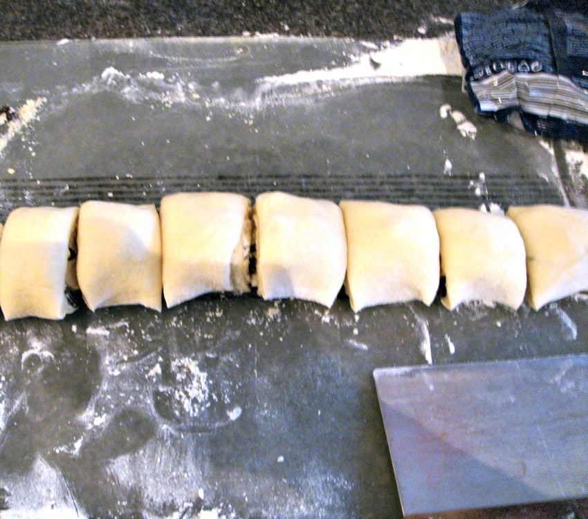 Pecan Maple Syrup Cinnamon Rolls showing shaping of dough