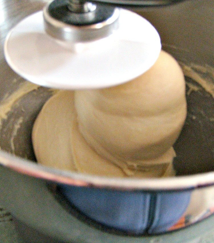 Orange Brioche Bread showing stand mixer and dough consistency