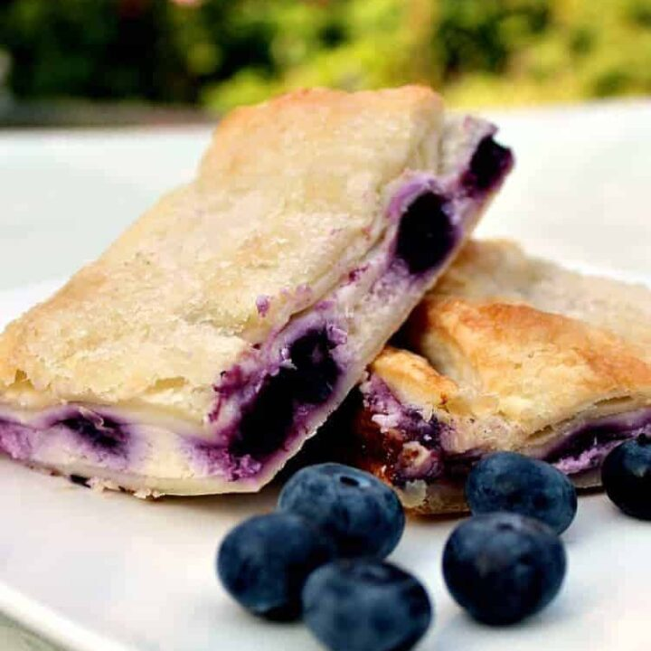 Blueberry Crescent Roll Cheesecake Bars. An incredibly easy recipe with cream cheese and blueberry filling sandwiched between layers of pastry. This tastes amazing!