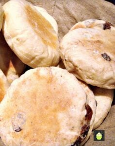 Cinnamon and Raisin English Muffins - Delicious opened and served warm with a nice spread of butter on each half!