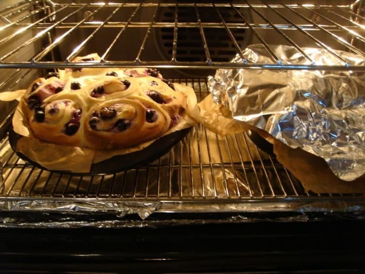 Blueberry Cream Cheese Swirly Bread showing buns in the oven