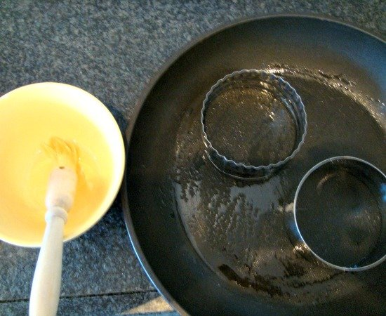 Perfect Warm Crumpets, greasing the pan and rings well to avoid sticking