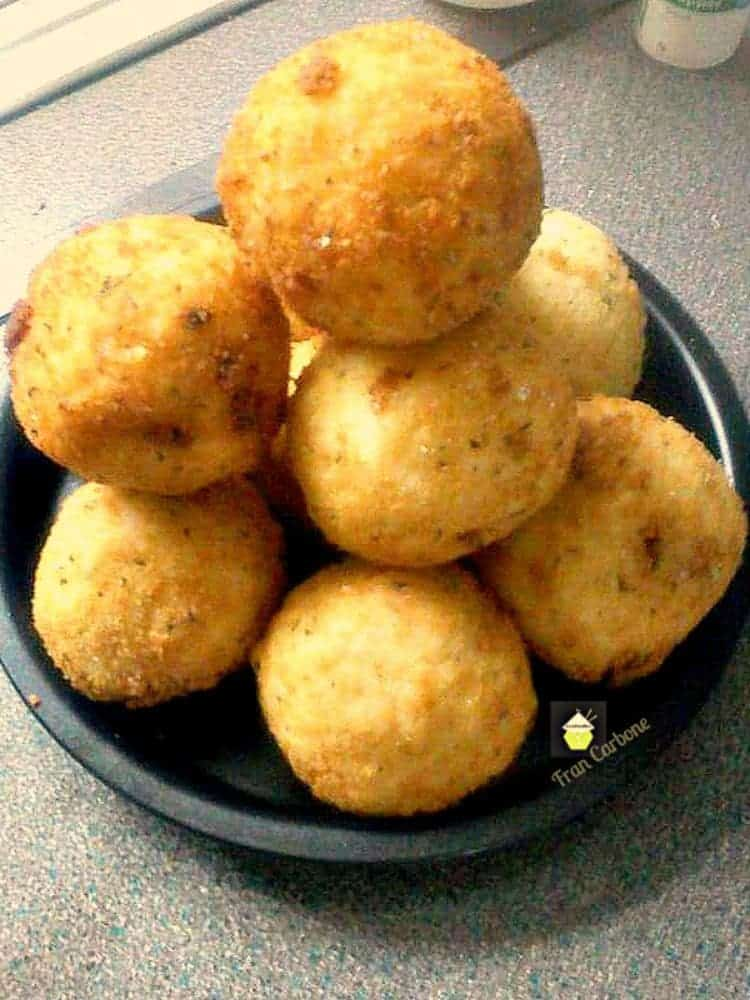 Italian Rice Balls. Easy to make, they take a little time but not hard to do, and of course all worth the effort once you bite into these little monsters!
