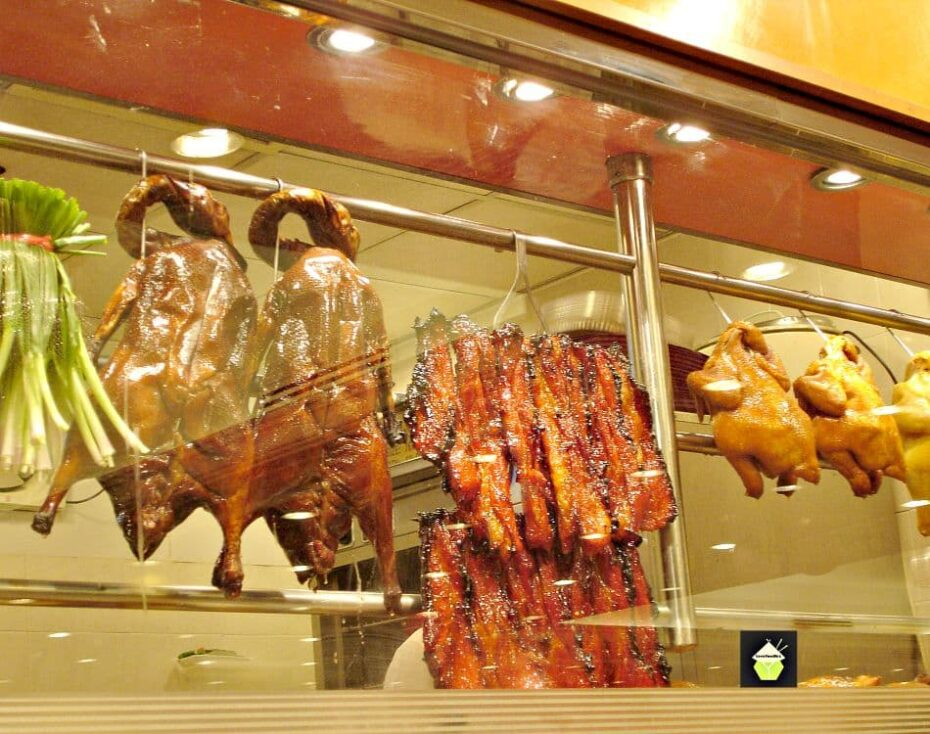 Char Sui Pork, Chinese Barbecue Pork, showing hanging ducks in Chinese restaurant