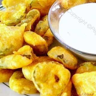 Crispy Fried Pickled Dills - All you have to decide is what your favorite dipping sauce would be! These are light and crispy and of course, absolutely delicious! Always popular with a crowd.