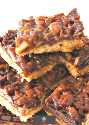 Easy Caramel Pecan Bars, luxurious caramel and pecan topping on a buttery shortbread cookie base. Like a pecan pie in cookie form! A really easy recipe too.