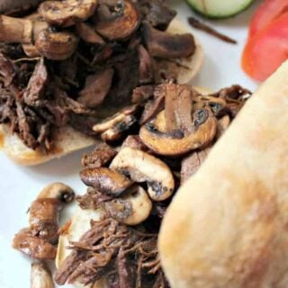 French Dip. Slow Cooked beef, a slice of cheese and sandwiched between a lovely toasted Ciabatta roll, and a bowl of au jus for dipping. YUMMY!