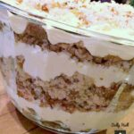 Italian Cream Cake Trifle, this is the most amazing trifle! Layers of classic fluffy Italian Cream Cake combined with delicious layers of creamy pudding, pecans and coconut will bring smiles to everyone who eats this! #Italian #Trifle #Christmas #Thanksgiving #