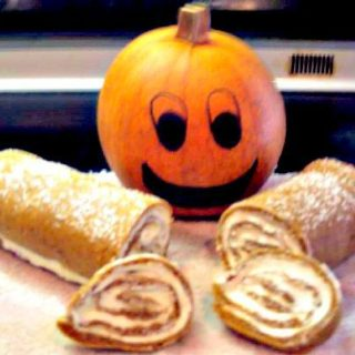 Pumpkin Roll Cake. A fun and easy recipe, and also instructions on how to make your own pumpkin puree.