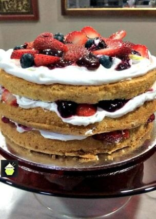 Mixed Berry Sponge Cake is a lovely layered red, white and blue cake bursting with goodies!