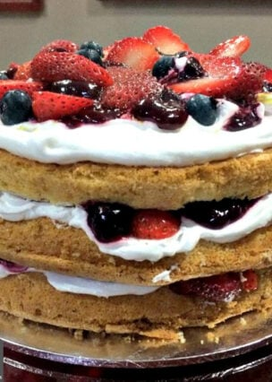 Mixed Berry Sponge Cake, lovely layers of light sponge between fresh whipped cream and a variety of juicy sweet fruit berries. A perfect cake for a tea party!
