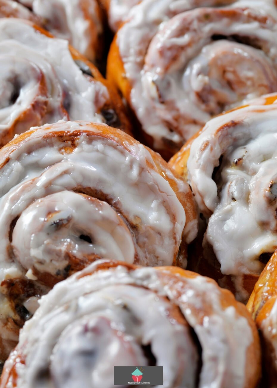 Pecan Maple Syrup Cinnamon Rolls. These are so yummy! Soft, sticky bread buns loaded with pecans and delicious Maple Syrup. Great served warm from the oven!