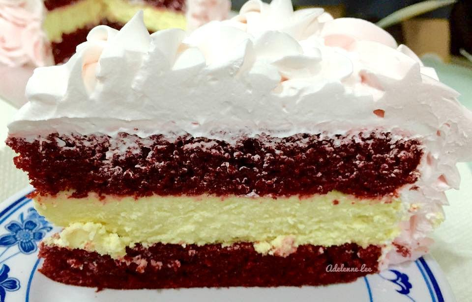 RED VELVET CAKE CHEESECAKE. It's a BIG WOW! Lovely vanilla cheesecake sandwiched between soft red velvet cakes and then topped with a light, fluffy puffy whipped cream frosting. It really is a WOW!