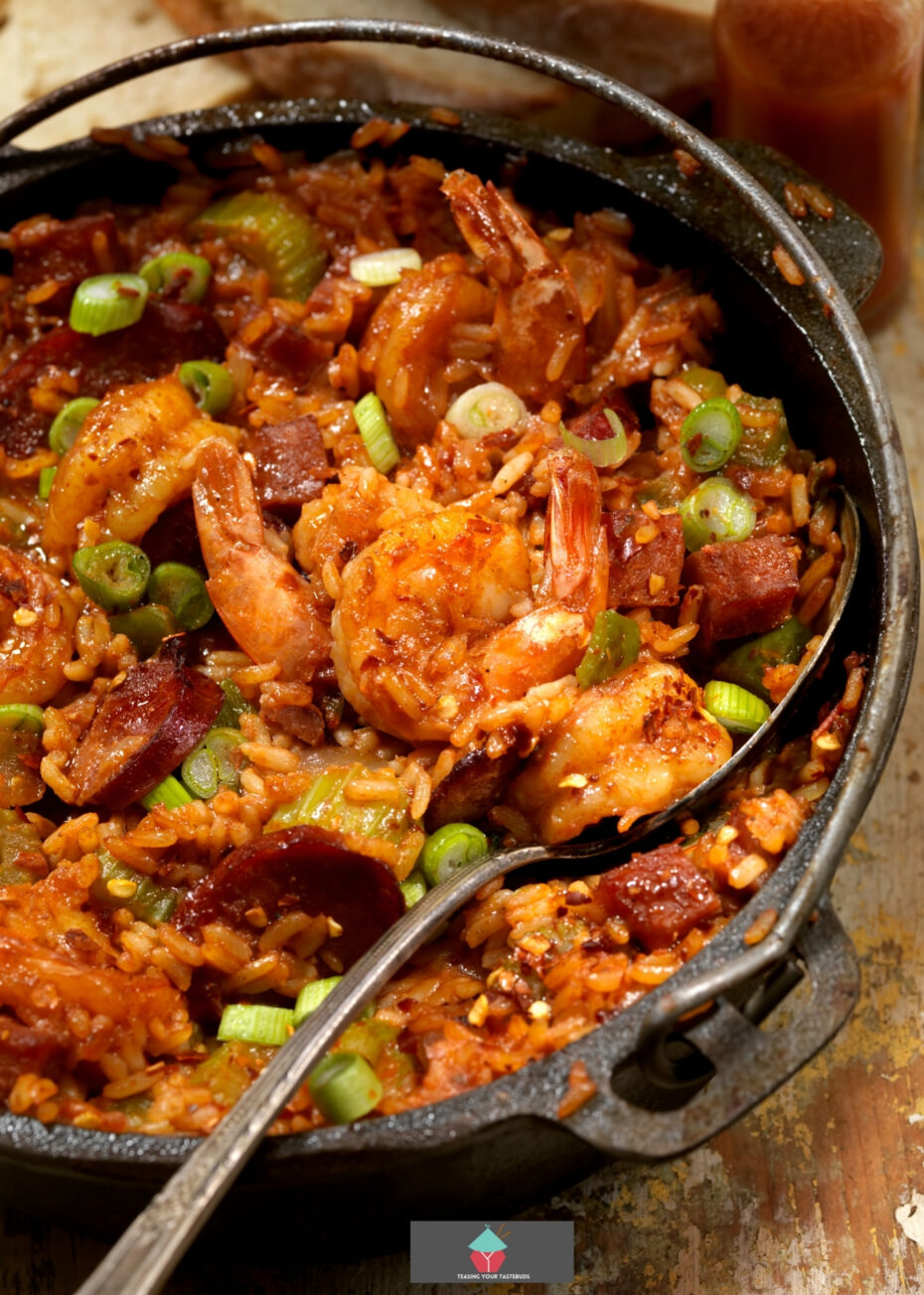 Homemade Jambalaya, a great family recipe, made from scratch. All in one rice dish with ham, smoked sausage, tomatoes and heaps of flavor. Serve as a dinner or pot lucks, parties