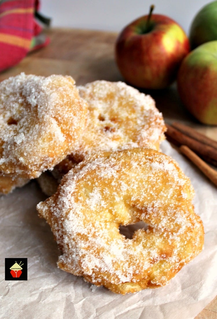 Apple Fritters. Yum! Slices of apple in a crispy light batter then coated in cinnamon sugar. Served warm with a drizzle of syrup, honey or a blob of ice cream.. makes for a perfect dessert! Quick and easy recipe too! | Lovefoodies.com
