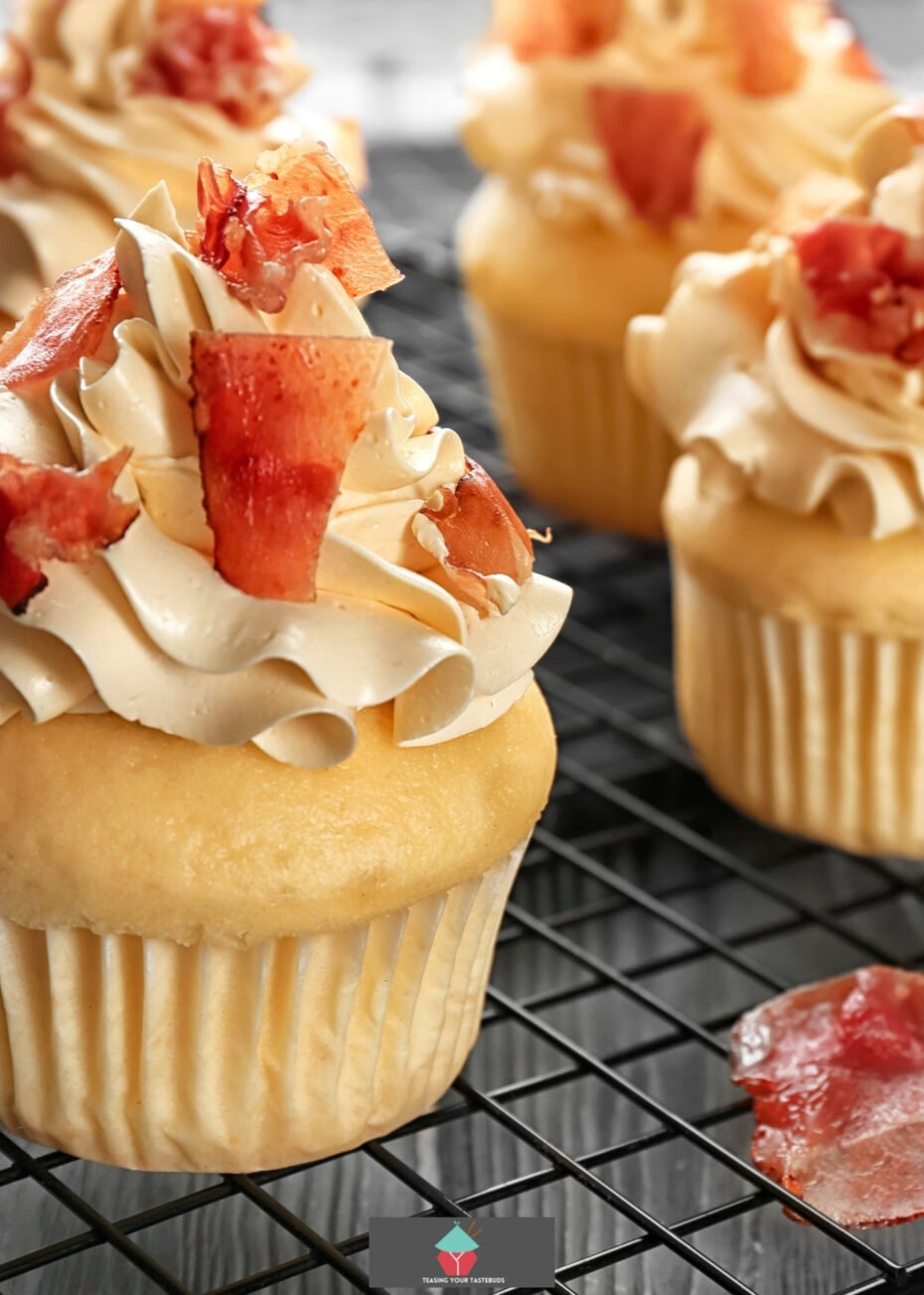 French Toast Cupcakes! These are wonderful soft and moist little cakes with a vanilla and maple flavor, frosted with maple cream and then topped off with some candied bacon. A super easy recipe and always so popular as a breakfast, dessert or for parties!