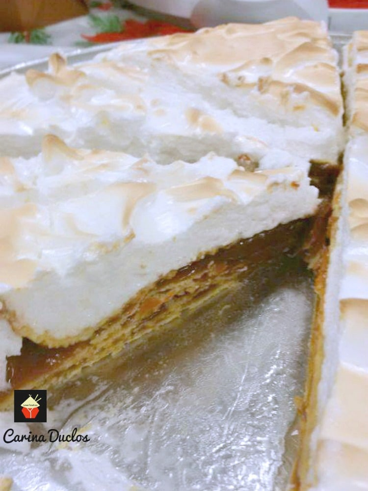 Alfajor Rogel! This is a wonderful cake famous in Argentina. It's traditionally made for special occasions, Christmas and other celebrations. The cake is made up of delicious layers of very thin sweet pastry, sandwiched together with Dulce De Leche then covered with a beautiful meringue. | Lovefoodies.com