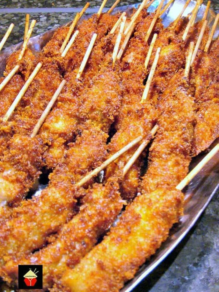 Breaded Chicken Skewers. These are a wonderful little appetizer or party food. Quick and easy to make and juicy to the bite too! Serve warm with your favorite dips. These always go fast at parties so be sure you make plenty! | Lovefoodies.com