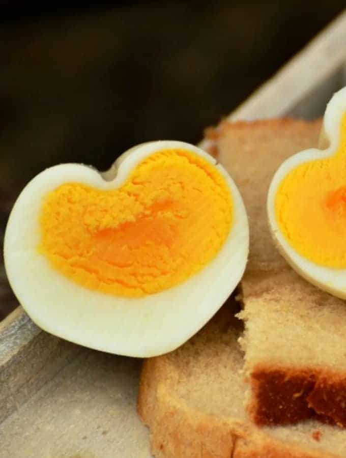How to Make Heart Shaped Eggs, a great tutorial for shaping hard boiled eggs into heart shapes. Great for a Valentine's Day breakfast!