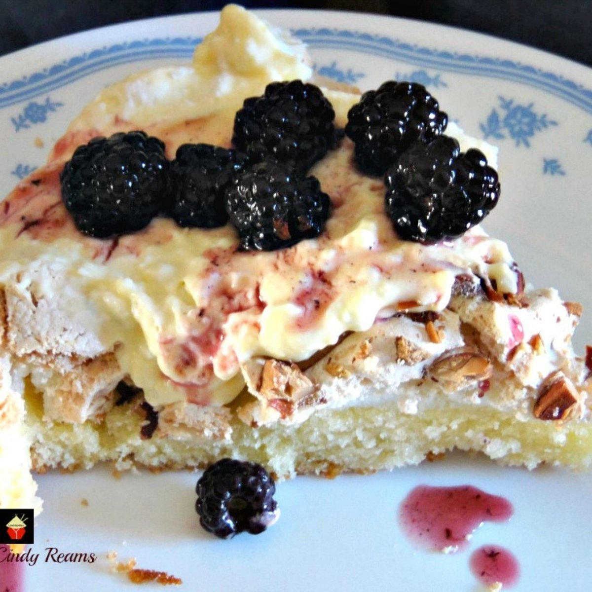 Rock Star Dessert! A delicious dessert made up of yellow cake and meringue and topped with whipped cream, delicious lemon curd and berries. It's a crowd pleaser!