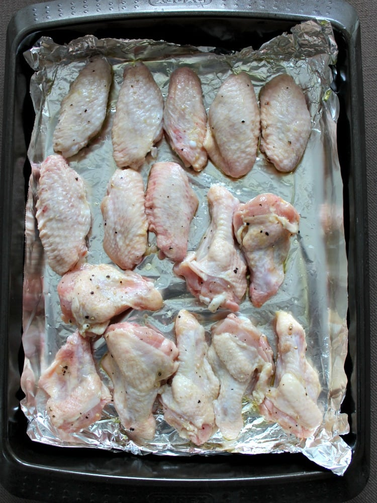 Zingy Lemon Butter Chicken Wings, showin wings laid out in baking pan