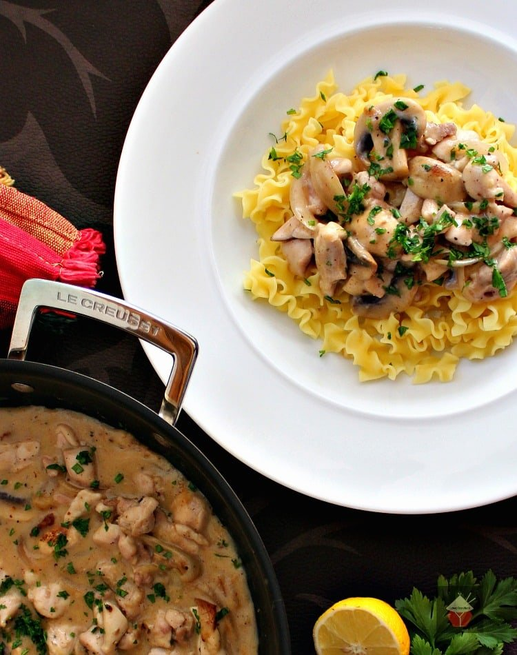 Creamy Chicken Stroganoff is a quick and easy dinner, with delicious strips of chicken and sauteed mushrooms in a creamy sauce using low fat yogurt! | Lovefoodies.com