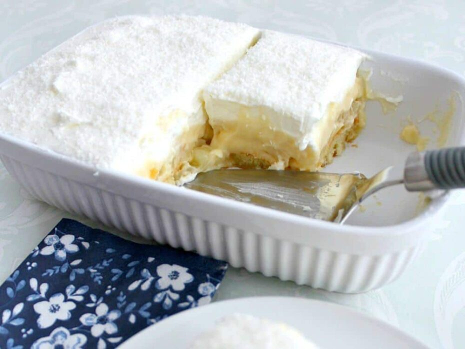 Dreamy Coconut and Pineapple Dessert. Layers of creamy smooth homemade coconut pudding layered between chunks of pineapple on a bed of pineapple infused lady's fingers and then covered with a wonderful dreamy whipped cream topping. Options to make adult too by adding a splash of malibu! This really is amazing! | Lovefoodies.com