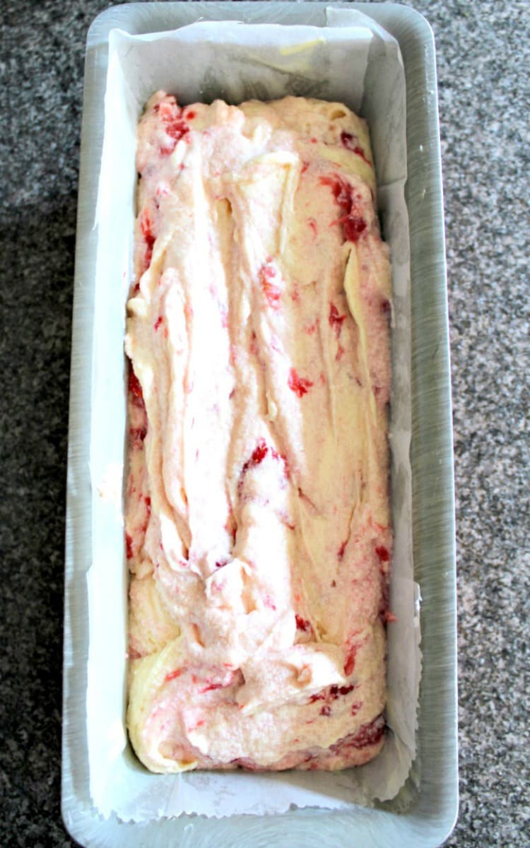 Strawberry Pound Cake showing cake batter spread evenly in baking pan