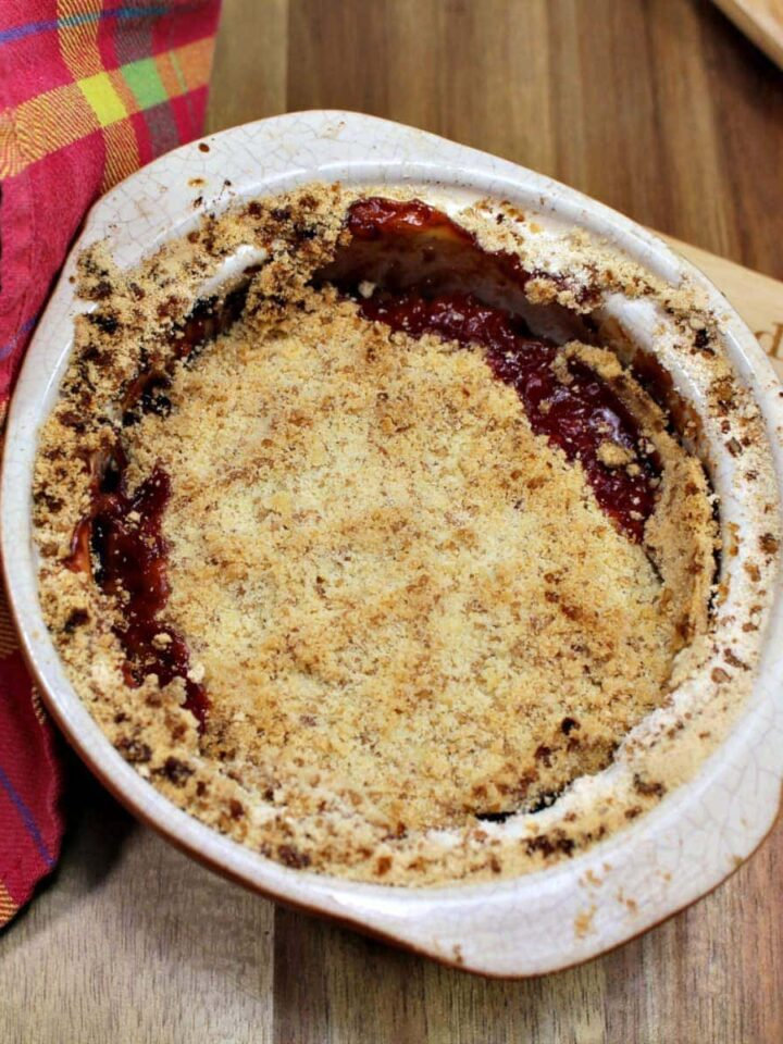 Best Ever Rhubarb Crumble. A delicious easy dessert with juicy sweet and tangy rhubarb and a crisp, crunchy topping. A perfect pudding made from scratch.