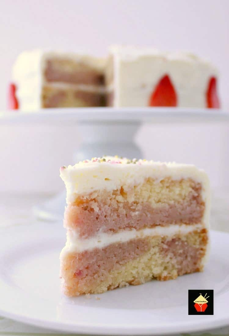 Strawberry and Vanilla Cake. A soft and moist cake bursting with delicious strawberry and vanilla flavors. It tastes out of this world! | Lovefoodies.com