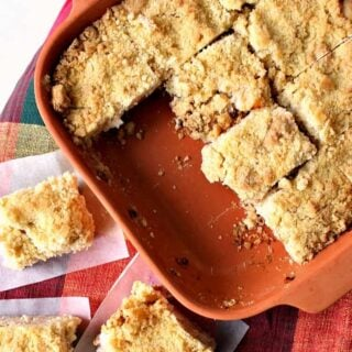 Delicious Apple Crumble Bars. These are absolutely out of this world! Chunks of apple filling on a lovely shortbread base and topped off with a delicious crumble. Really easy recipe too! | Lovefoodies.com